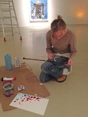 Preparator Tina meticulously paints the holding magnets in order to camouflage them